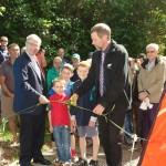 John Spiller holding ribbon for Mayor Len Brown to cut at the opening of the Kowhai? walkway